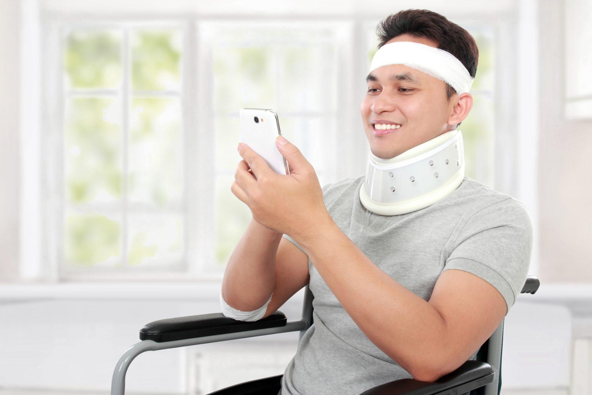 injured man on smartphone